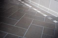 narrow perimeter border tile + rug pattern using mosaic border tile with chevron inset