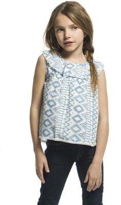 Blusa sin mangas con estampado celeste. Abotonada por detrás. 100% algodón.  Tallas 4, 6 y 8 años.  En www.sunestkids.com