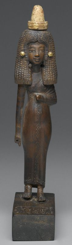 Standing Wood Gilded Statue of Lady Tuty - Egypt ca. 1390-1352 B.C.E.  Ancient Egyptian men and women wore cones of perfumed grease on their heads that would would melt in the warm air and give off a sweet smell.