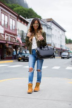 Street Style: Timberlands. - Mia Mia Mine. Timberland Boots, Topshop Bomber Jacket, Levi's Jeans,  Givenchy Bag