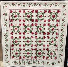 Hand quilted applique Cherry Rose Love the colors, shapes and background quilting!  Beautiful work.