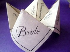 Wedding Fortune Teller: These adorable fortune tellers can be personalized with 8 questions about you and your fiance, while also having enough room for extra information in the center square. To put on the tables with the view finders :)
