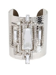 Geometric sparkle is the cornerstone of this deco-inspired cuff.  We think the mix of bold silver and jaw-dropping graphic crystals would be enough to make Daisy Buchanan blush.
