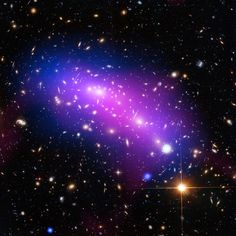 Hubble Looks Into a Cosmic Kaleidoscope This cosmic kaleidoscope of purple blue and pink marks the site of two colliding galaxy clusters. March 25 2016