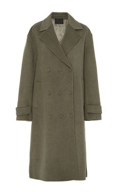Rendered in a splittable brushed wool, this **Alexander Wang** coat features a notch lapel with a double breasted silhouette, triple snap details at the front, and an oversized relaxed silhouette.