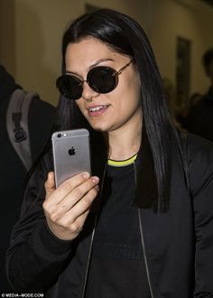 Bold look: Jessie J showed off her septum ring when touching down at Sydney airport on Mon...