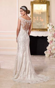 This satin sheath wedding dress from the Stella York bridal gown collection boasts an illusion lace bateau neck with sweetheart styling. See more inside. #weddingdresses