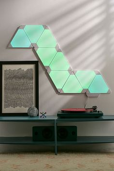 Shop Nanoleaf Aurora Smarter Modular Lighting System Kit at Urban Outfitters today. We carry all the latest styles, colors and brands for you to choose from right here. Bedroom Lighting, Home Lighting, Bedroom Setup, Dream Bedroom, Lighting Design, Bedroom Decor, Nanoleaf Designs, Nanoleaf Aurora, Nanoleaf Lights