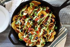 Easy paleo nachos made with shredded chicken, sweet potato chips and a special avocado sauce that's the perfect replacement for cheese. Must-try paleo recipe!