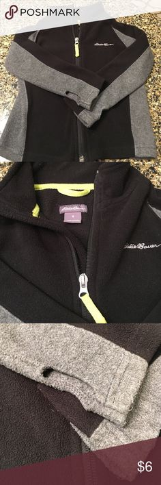 Sz. 4-T Eddie Bauer Fleece Jacket Super cute and 2-toned with black and grey. There is a neon yellow stripe along the inside neck and on the zipper pull. Thumb holes manufactured to be cut out to keep little hands warm. Eddie Bauer Jackets & Coats