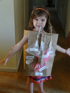 wearable human body out of brown paper grocery bags, pasta, plastic bags, yarn, straws, and other things! The lungs really inflate when you blow them up through the straw!