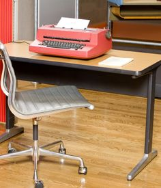 Eames Aluminum Group Side Chair  The side chair is a low-back, arm less chair that works as well at home as in the office.
