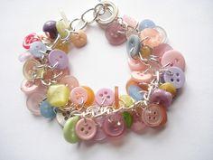 Button charm Bracelet - pastels by NiNEFRUiTSPiE, via Flickr