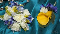 Here is an example of a bridal corsages and boutonniere with white roses and yellow calla lilies. These are perfect for a spring or summer wedding!
