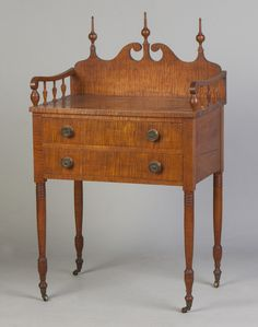"Title Fine Sheraton Tiger Maple Two Drawer Side Table Description Early 19th cent. Gallery back, cut out scroll ending in three finials. Condition Old finish, possibly original. Period brasses. Dimensions Ht. 41"" W 25"" D 16"""