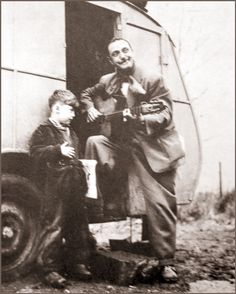 Django Reinhardt and friend.  Django overcame a crippling hand injury to become a unique guitar talent