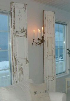 Repurposed vintage painted shutters instead of drapes.  Upcycle, Recycle, Salvage!  For ideas and goods shop at Estate ReSale & ReDesign, Bonita Springs, FL