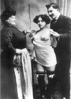 A picture from the turn of the century of a French prostitute with her madame and a client. © The Granger Collection, New York.