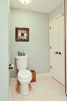 """another pinner says,   """"we selected a pale sea-colored paint for the walls (Sherwin Williams """"Escape Gray"""") that has subtle color shifts from blue to green to gray depending on the lighting elements and is the perfect compliment to the warm beige tones in the shower and floor tiles. """""""