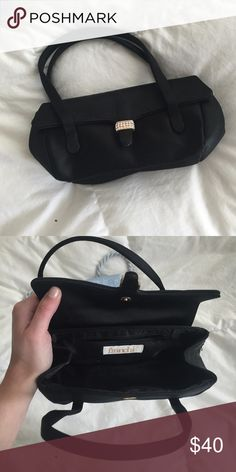 Formal black tie mini purse with diamond detail Franchi black mini purse. Great for black tie or formal event. With good storage! Franchi Bags