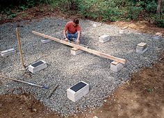 Solid-concrete blocks are ideal for building on-grade foundations. The blocks are aligned in rows and checked for level with a long, straight 2x4 and a 4-ft. level.  [shed decking].