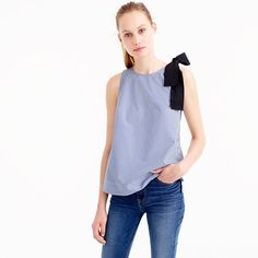 """We crafted this pretty top with a bow at the shoulder for a feminine touch. Plus, stripes! We also designed pants to match, for a coordinating head-to-toe look we like to call a """"hookup."""" <ul><li>Body length: 25"""".</li><li>Cotton.</li><li>Machine wash.</li><li>Import.</li></ul>"""