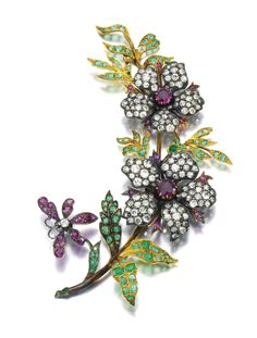 GEM SET AND DIAMOND BROOCH, LATE 19TH CENTURY Designed as a floral spray, set with circular-cut and rose diamonds accented with mixed- cut emeralds and rubies, detachable brooch pin to reverse