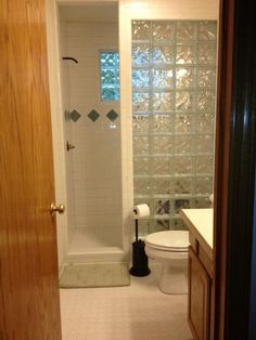 My husband helped me take out the tub and I built a walk in shower with the glass block wall.