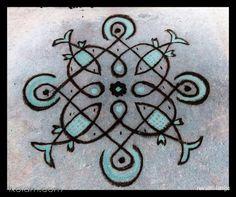 Rangoli Rev's chikku kolam 50. 7 to 1 straight dots. | www.iKolam.com