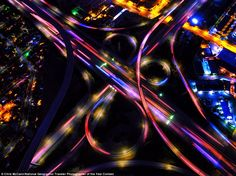 This spectacular shot shows freeway interchanges at night in Los Angeles, which has a repu...