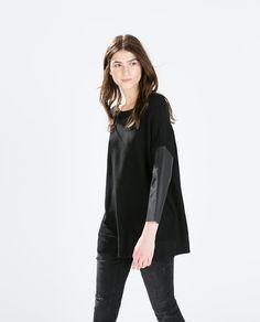 SWEATER WITH FAUX LEATHER SLEEVES from Zara