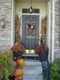 Decorating the front door for Fall!  Market Flower Bucket and Hanger can be purchased through Willow House.