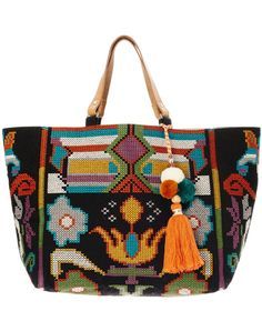 Designed with bold and vibrant Mexican inspired embroidery, the Vita tote is made from durable cotton canvas and finished with leather handle, pom pom and tassle trim. Brilliant in size to carry all your day to day essentials.  Colour: Faded Black/ Multi  Height: 33cm Width: 39cm Depth: 20cm Handle Drop: 19cm