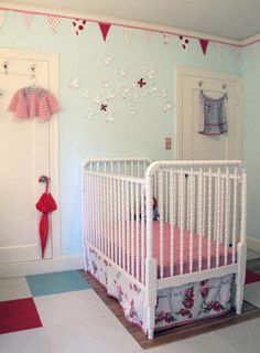 Light blue walls with red accents and a white Jenny Lind crib... perfect!
