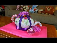 In this Video Thom shows you how to make a fun Teapot Diaper Cake! Just another fun idea you can try at the next baby Shower you may attend. All Music is Royalty Free, Self Owned and Created, made with Magix Music Maker MX royalty free music software. Teapot Diaper Cake, Baby Shower, Baby Gift, Nappy Cake