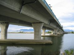 A shot from under the No. 2 Road bridge connecting Richmond to Vancouver through Vancouver's International Airport. International Airport, British Columbia, Marina Bay Sands, Vancouver, Gap, Bridge, City, Building, Travel