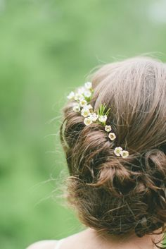 bridal updo with small white flowers