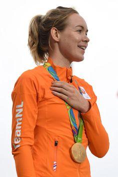 Anna Van Der Breggen poses on the podium after winning the Women's Road Race Rio…