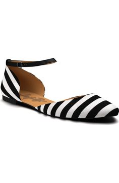 A slim ankle strap lends a touch of modern polish to these lithe, two-tone d'Orsay flats that serve as an everyday staple.