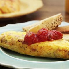 "Omelet in a Bag | ""I loved this recipe! We made it at a family gathering and it was a hit. One tip, write names on the zip lock bags with permanent markers before cooking because after cooking they all look the same."""