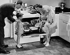 Vintage oven advert circa 1950s.. those kids are standing WAY too close...