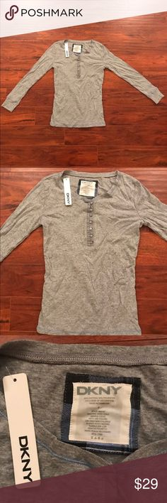 NEW DKNY LONG SLEEVE SHIRT TOP NEW DKNY GRAY LONG SLEEVES WOMENS TOP. Size: S 40% COTTON 40% POLYESTER. MADE IN CAMBODIA Dkny Tops Tees - Long Sleeve