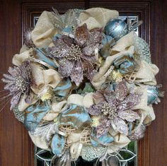 I have a tough time deciding what my Christmas style is. I love the look of simplicity, all natural elements as shown in this wreath made with chilis.