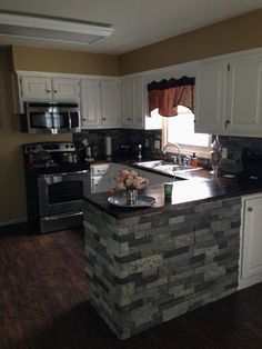 Airstone Backsplash and wood countertopsFor the Home