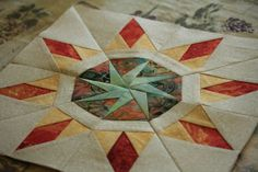 paper pieced quilt block  fire and ice?