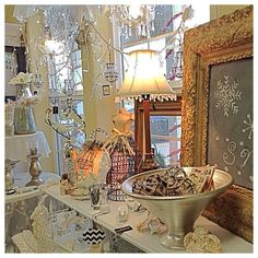 Winter January Window, Shop Display with twinkle lights, mini Crystal chandlers, winter white with sparkly gold and silver accents make this display sparkle!