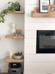DIY shiplap fireplace with electric insert; and floating shelves. Decor, Rustic Fireplaces, Daylight Savings Time, Home, Decor Design, Diy Shiplap, Wooden Fireplace, Diy Shiplap Fireplace, Fireplace