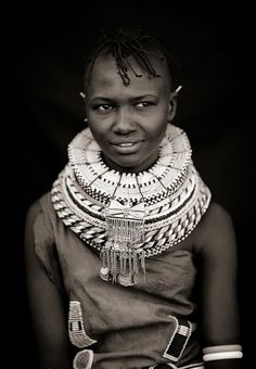 Beloved Continent --- Africa | Turkana girl with pendants on her beaded necklace. Kenya | ©Eric Lafforgue