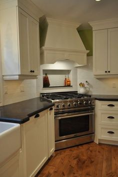 Shelf behind stovetop provides space for oils, etc. that would otherwise be flat:  traditional kitchen by Isabel Beattie @ K Cabinets Oakville