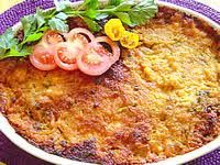 Surinam food: Pom is a popular and festive dish. In a high dish, put sautéed chicken pieces between two layers of raw, grated pomtajer which is mixed with citrus juice and a sauce made from oil and/or margarine, onions, tomatoes, salt, pepper and nutmeg. Bake until golden brown.